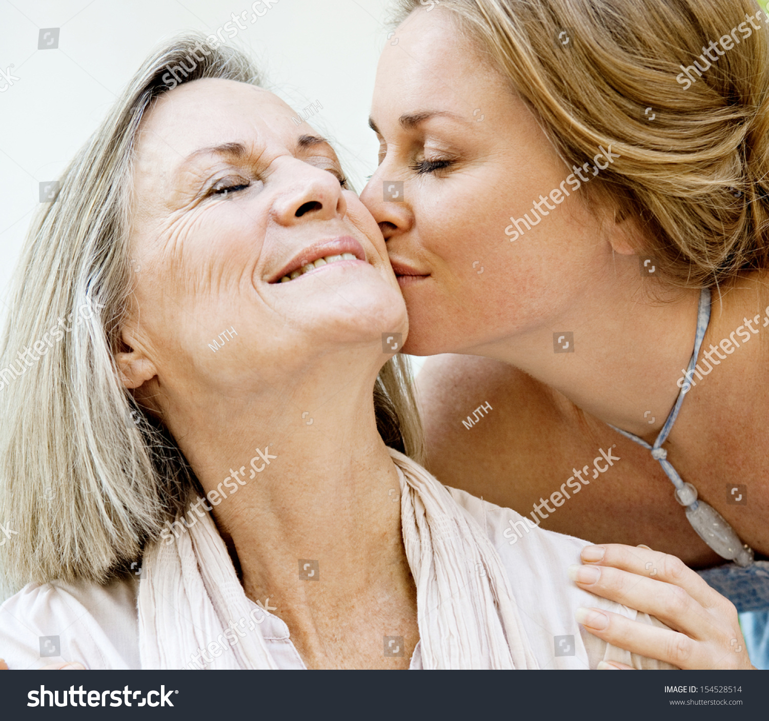 close portrait adult daughter kissing her stock photo (royalty free