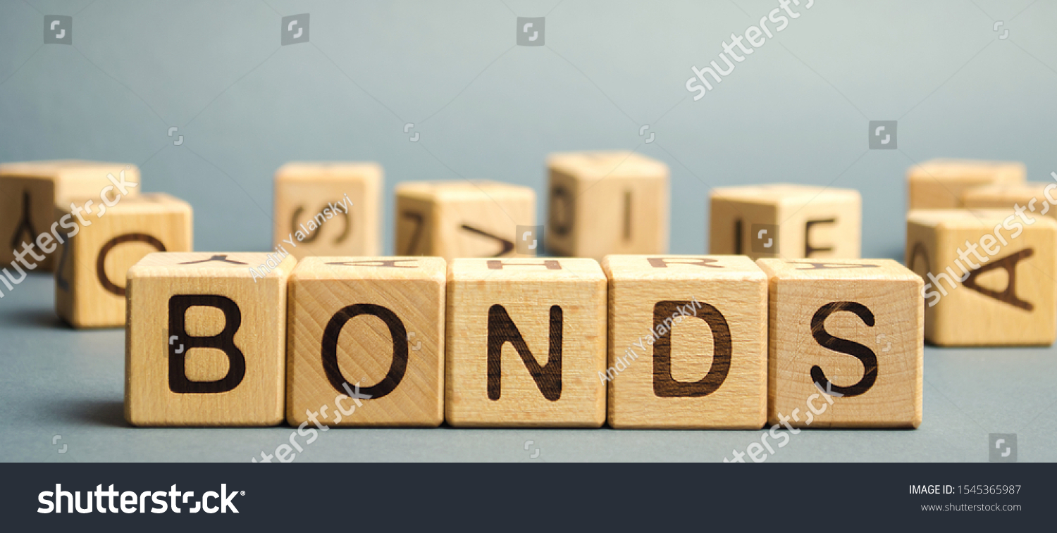 Wooden blocks with the word Bonds. A bond is a security that indicates that the investor has provided a loan to the issuer. Equivalent loan. Unsecured, secured bonds. Business and finance #1545365987