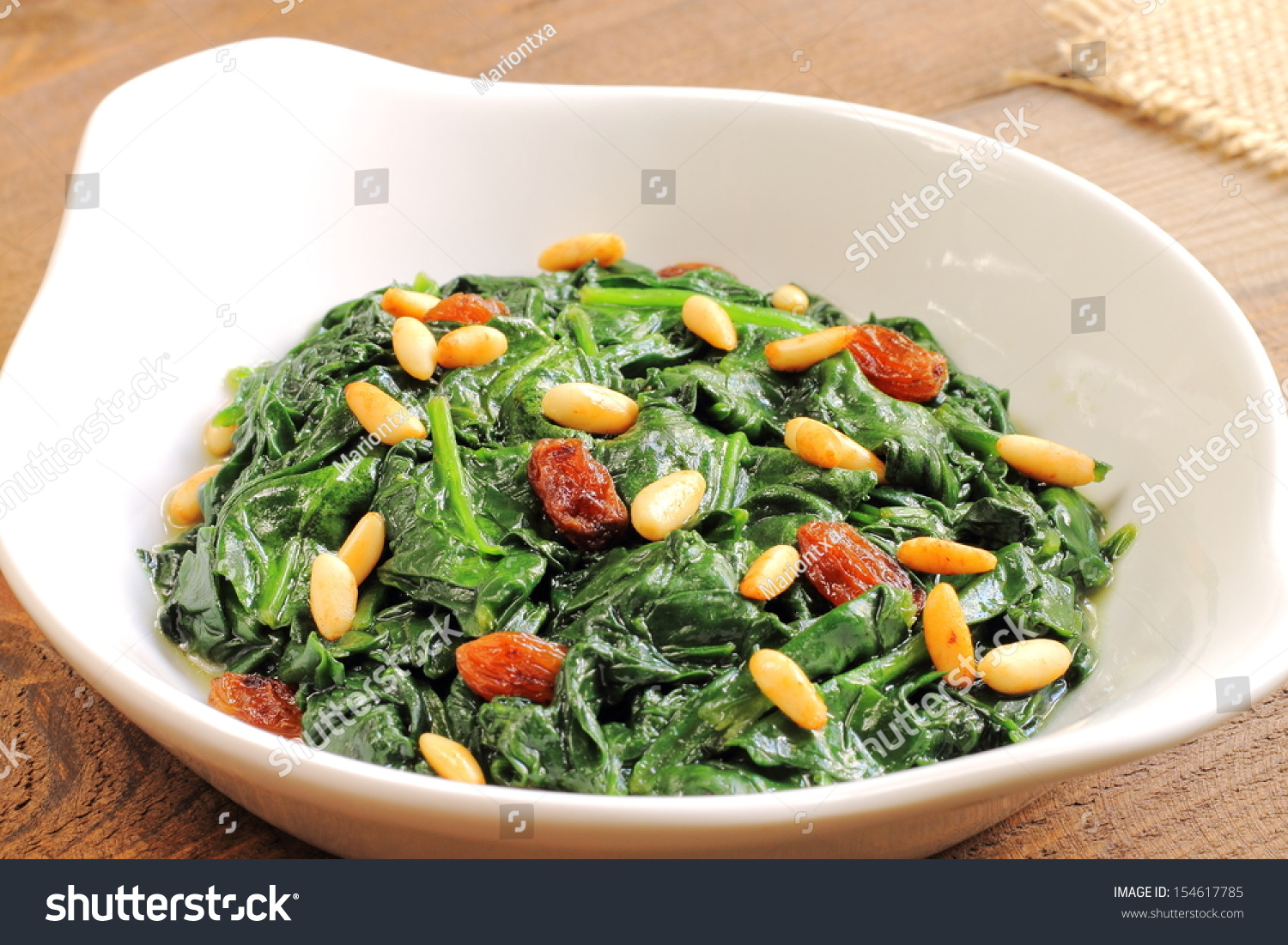 Spinach Catalan style, with raisins and pine nuts, a traditional ...