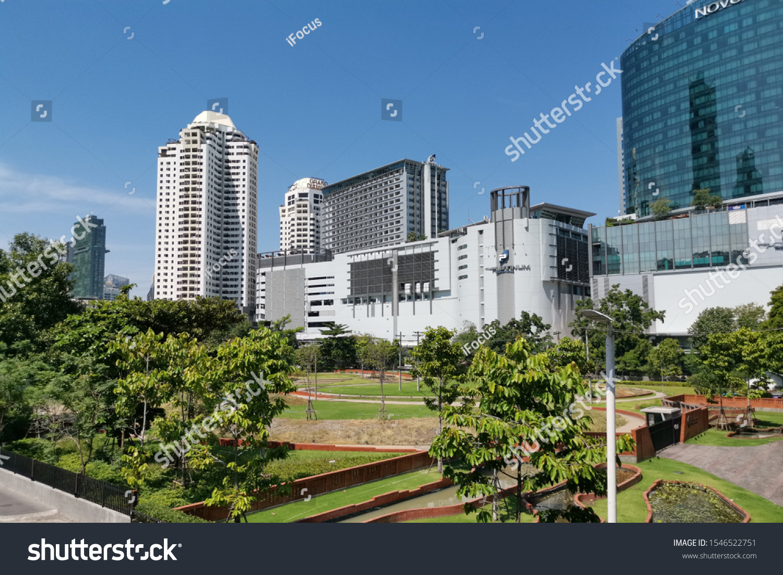 BANGKOK, THAILAND - OCTOBER 31, 2019: Modern buildings rise beyond Pathumwan Anurak Park on October 31, 2019 in Bangkok, Thailand