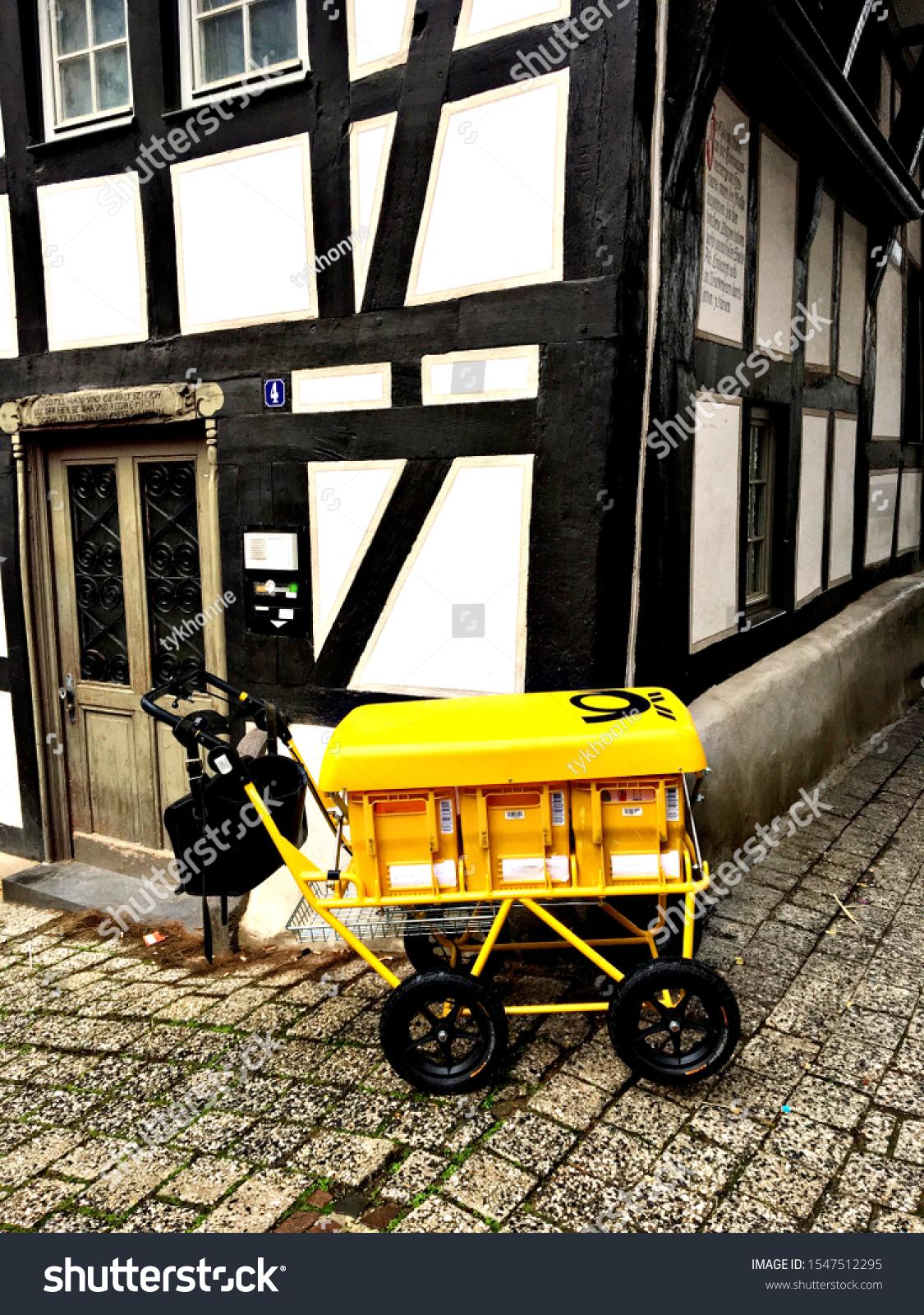 stock-photo-vintage-yellow-postal-wagon-