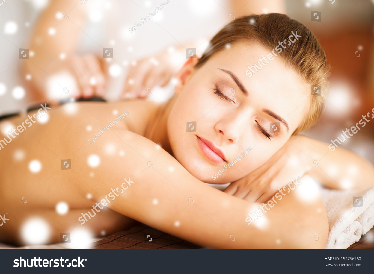 health and beauty concept woman in spa salon with hot stones stock photo 154756760 shutterstock. Black Bedroom Furniture Sets. Home Design Ideas