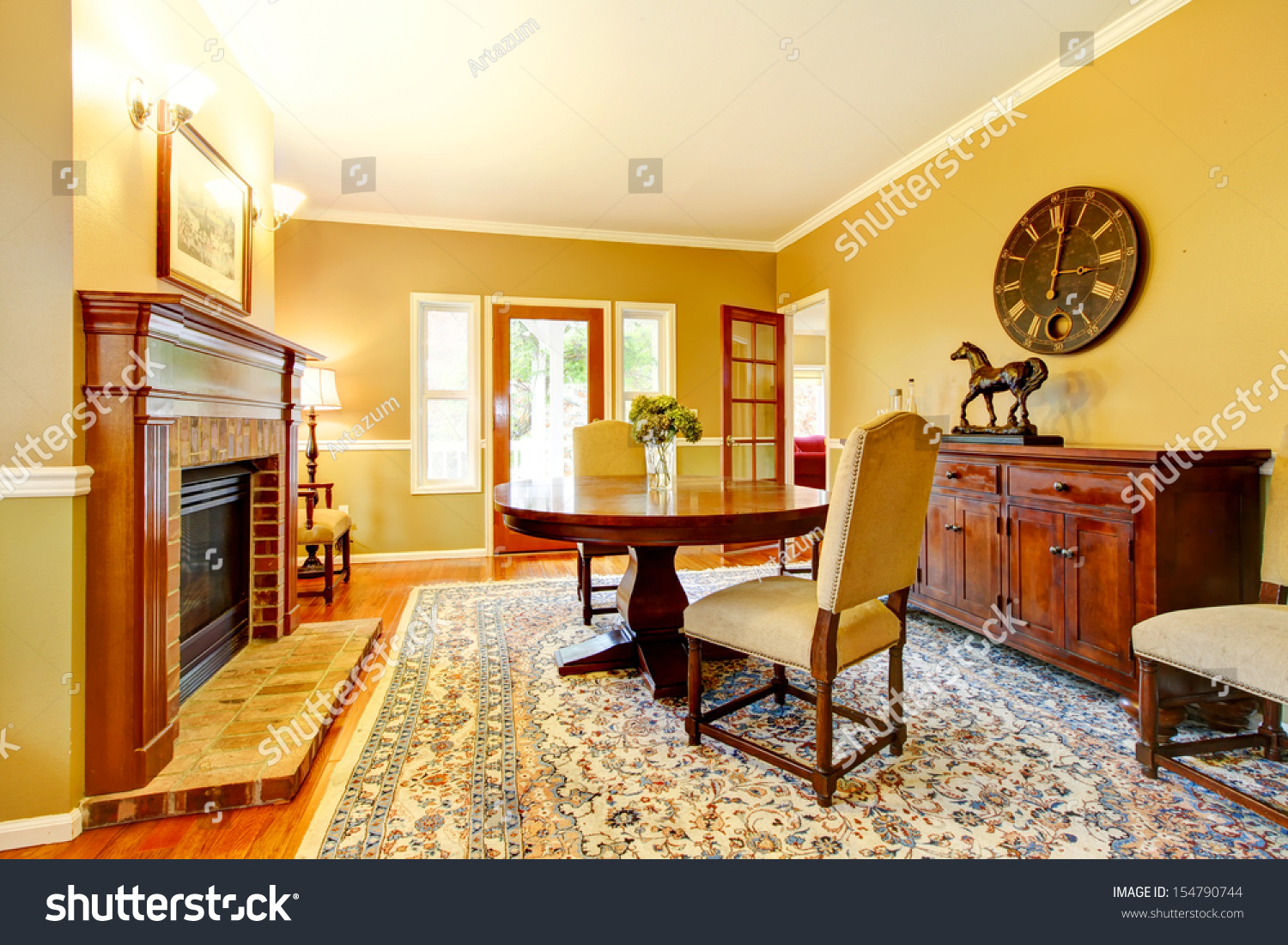 Living room fireplace mustard wall color stock photo for Mustard living room ideas
