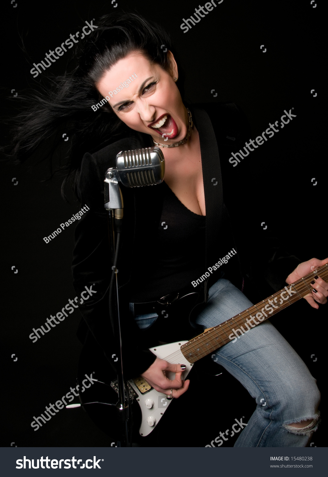Female Musician Performing With Guitar And Retro Mic