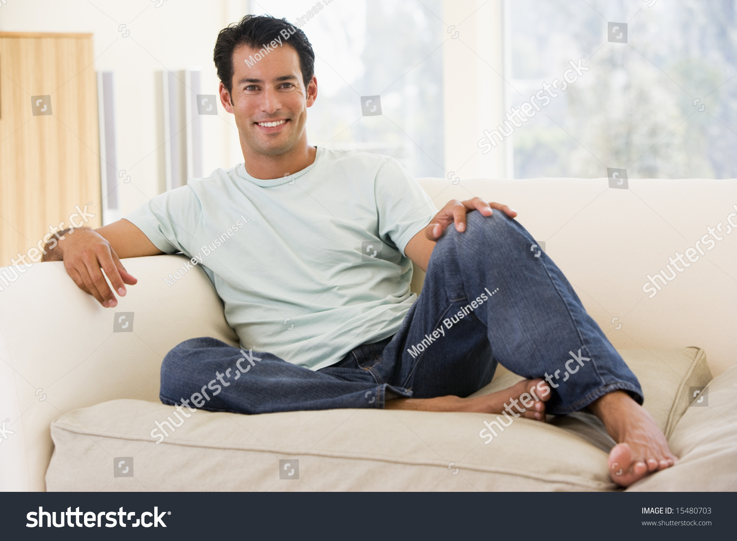 Man Living Room Man Sitting Living Room Smiling Stock Photo 15480703 Shutterstock