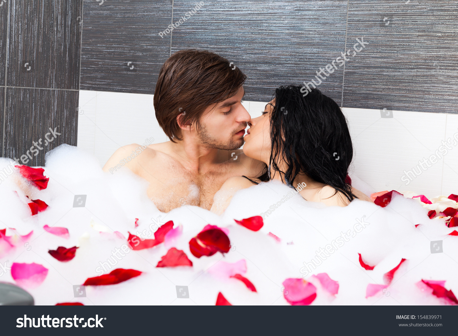 Young couple in tub