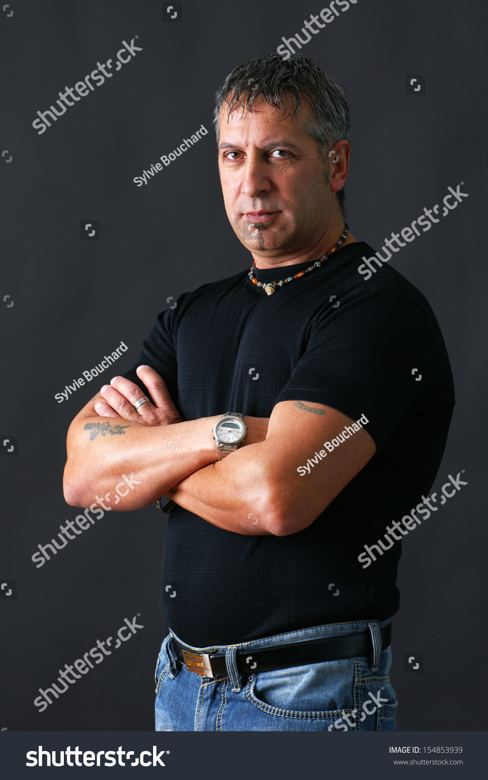 15 Year Boys Bedroom: Serious Or Angry Tough Guy Looking At Camera Stock Photo