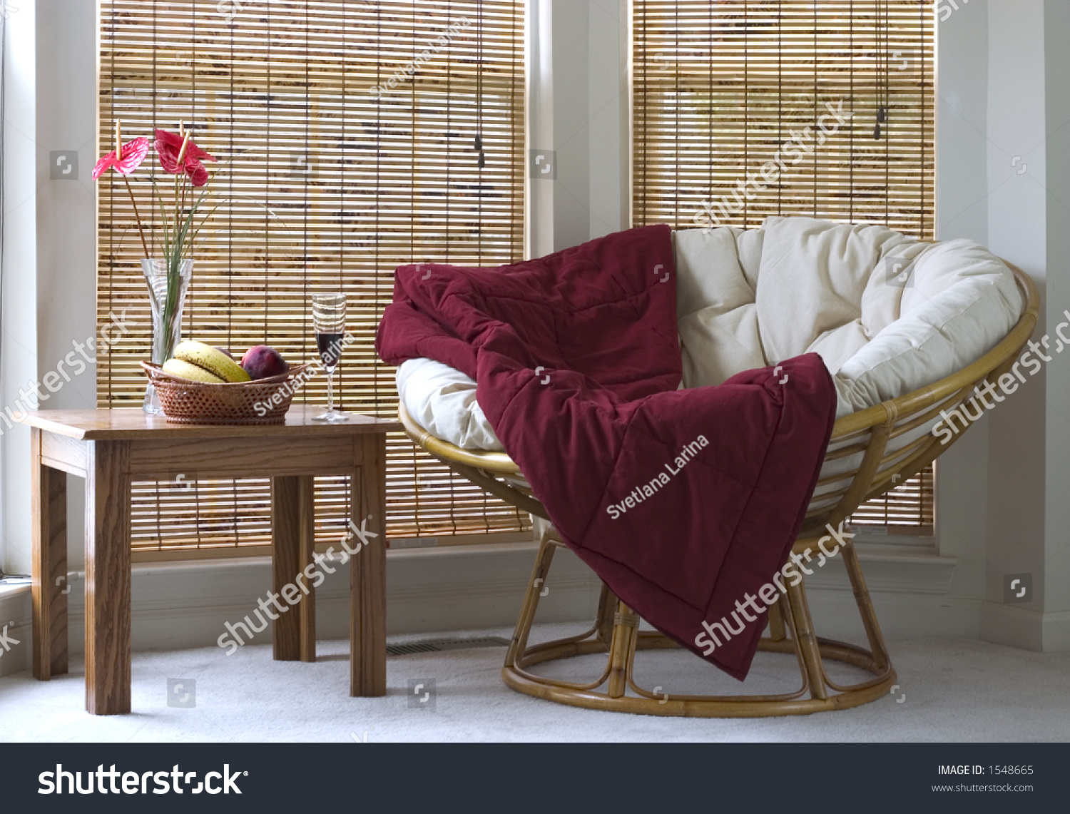 Papasan Chair In Living Room Papasan Chair Near Coffee Table With Wine And Fruits Stock Photo