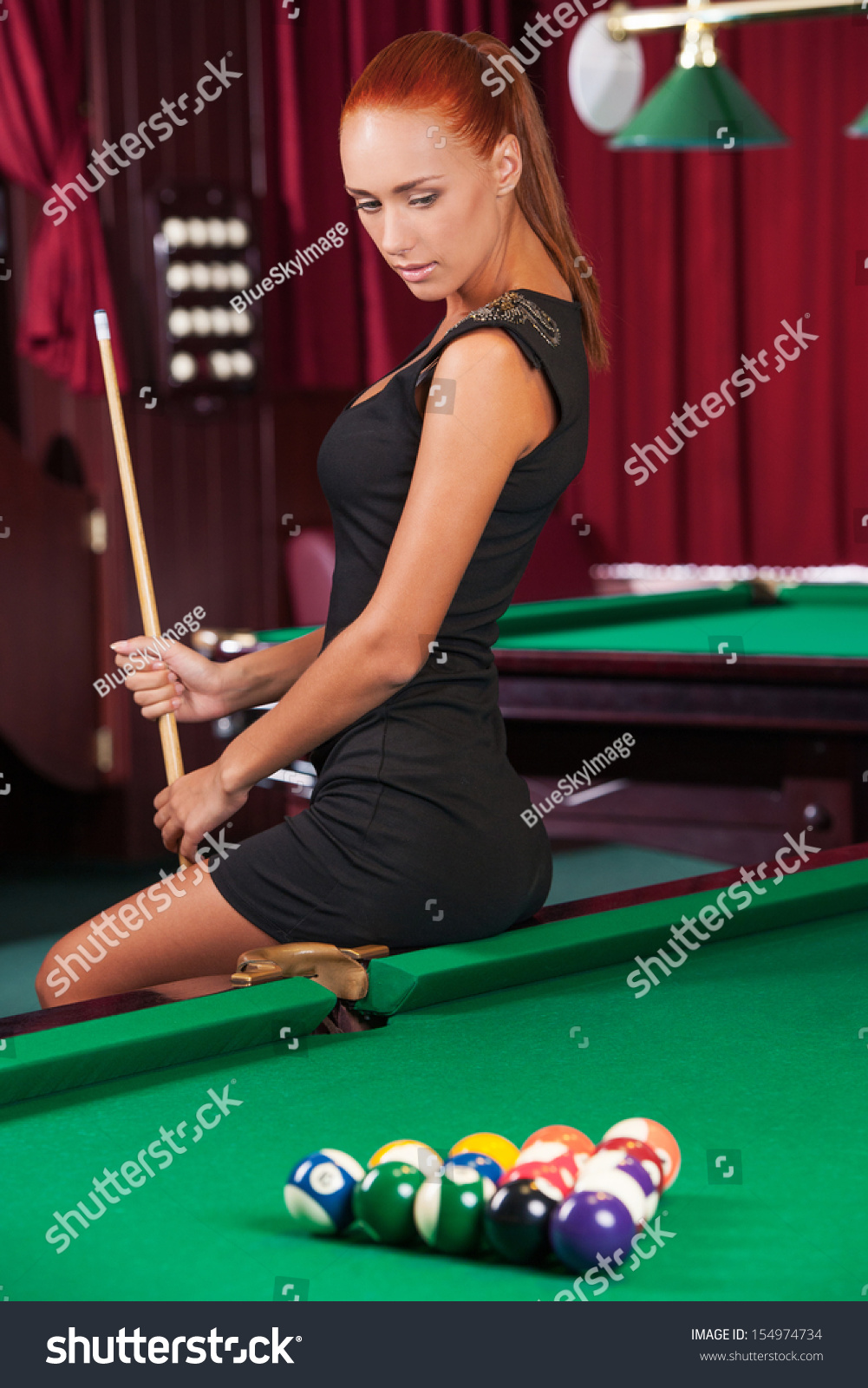 Nude women with pool cues