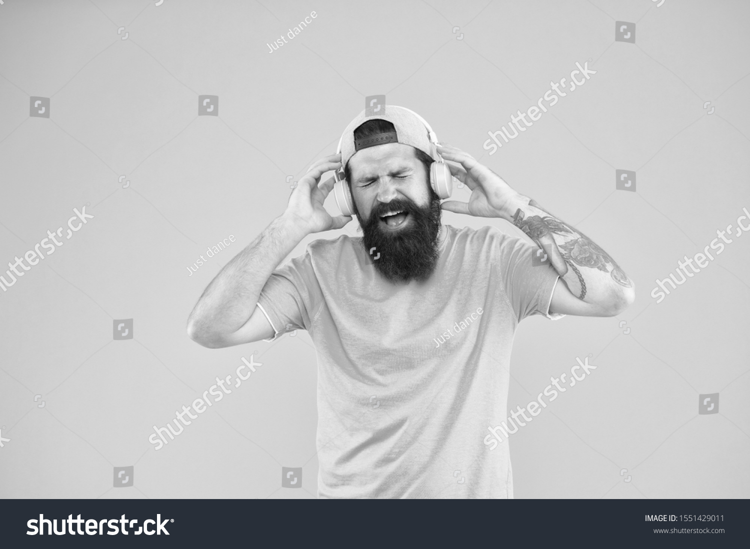 Music library. Feel rhythm. Bearded guy enjoy music. Equalizer player settings. Lifestyle music fan. Man listening music wireless headphones. Bass low sound. Hipster headphones gadget. Inspiring song. #1551429011