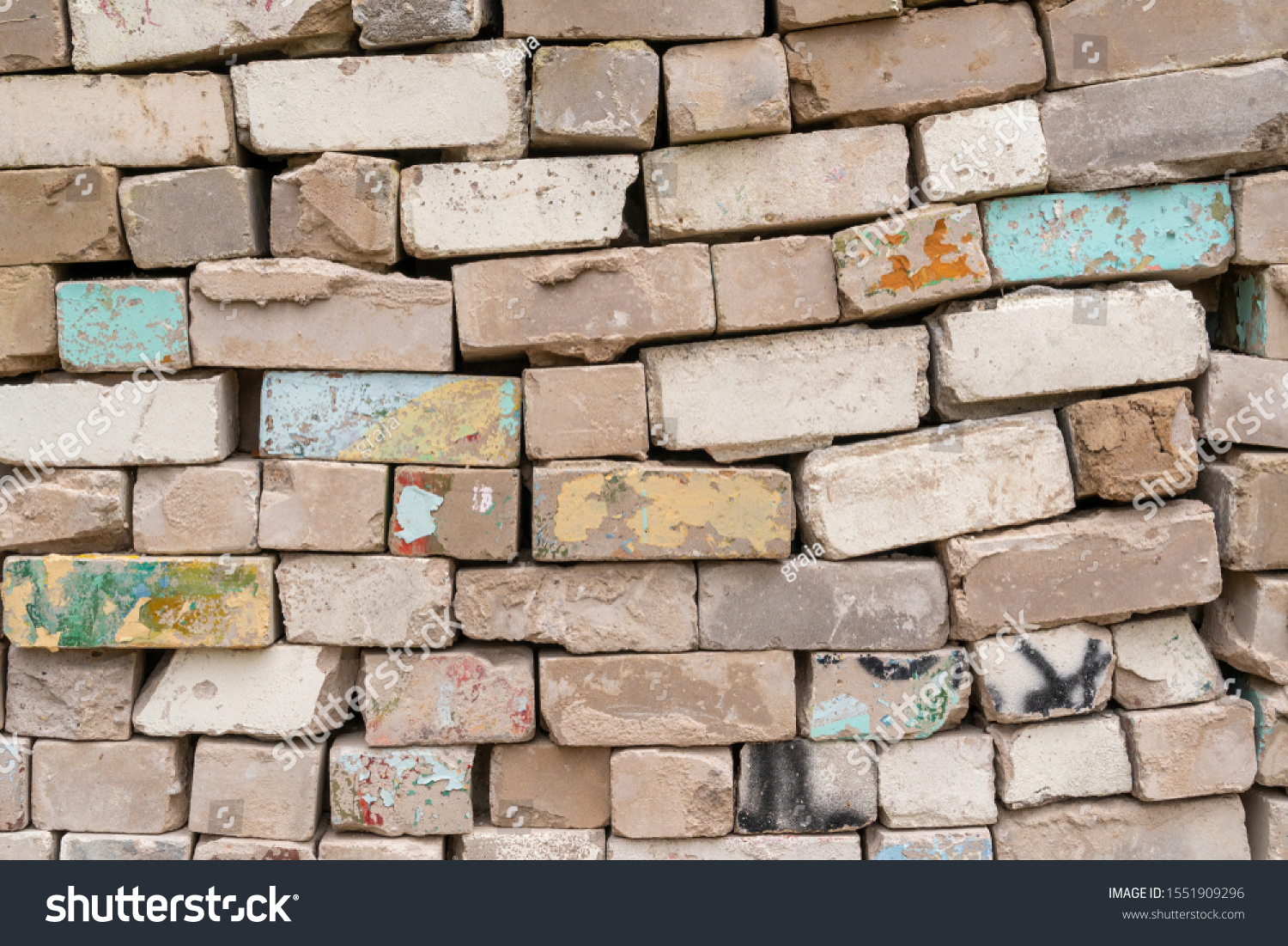 Bricks pile close up view. Old Bricks Texture.  Construction industry raw materials. Building materials.  #1551909296