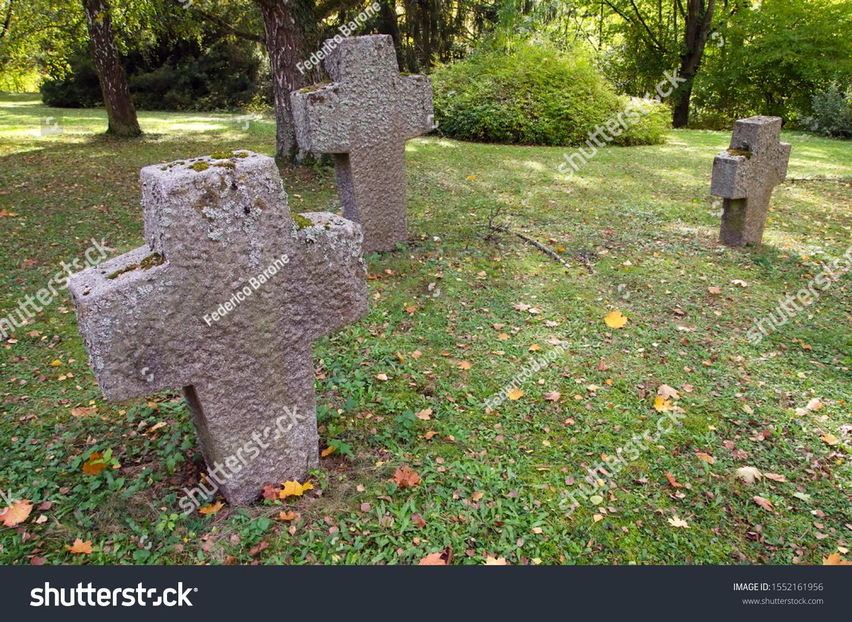 stock-photo-three-stone-crosses-in-an-ol