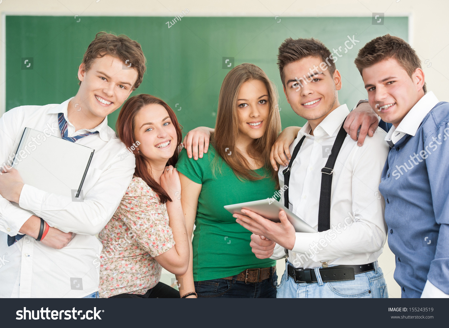 Modern Classroom Students ~ Five smiling modern students posing in a classroom stock