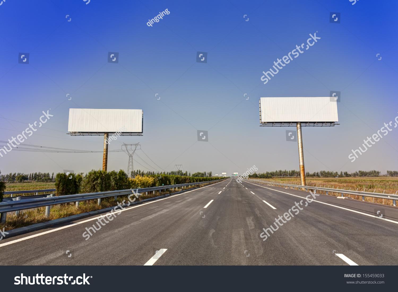 blank billboard by highway stock photo 155459033