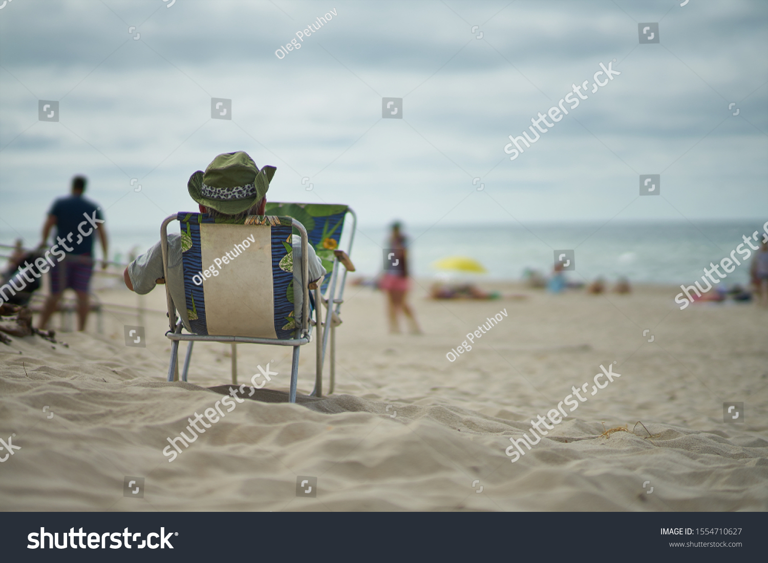 Resting man at the beach. Man relaxing at the beach     #1554710627