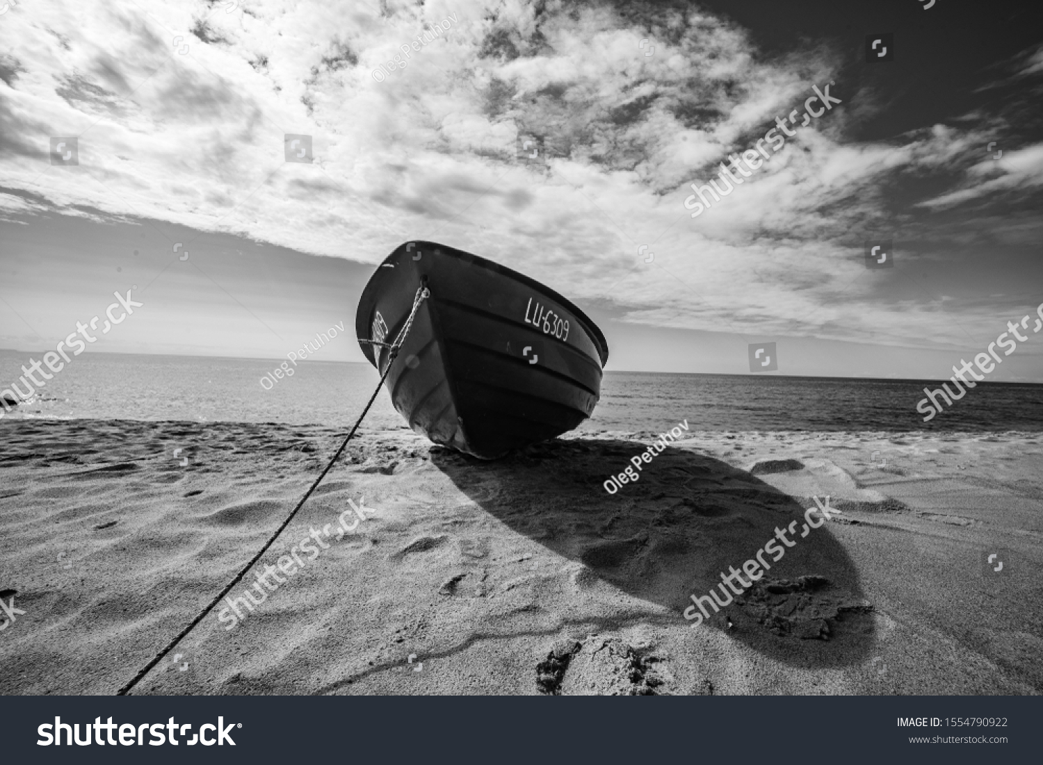 Wide angle shot of the boat. Wooden boat at sea cost #1554790922