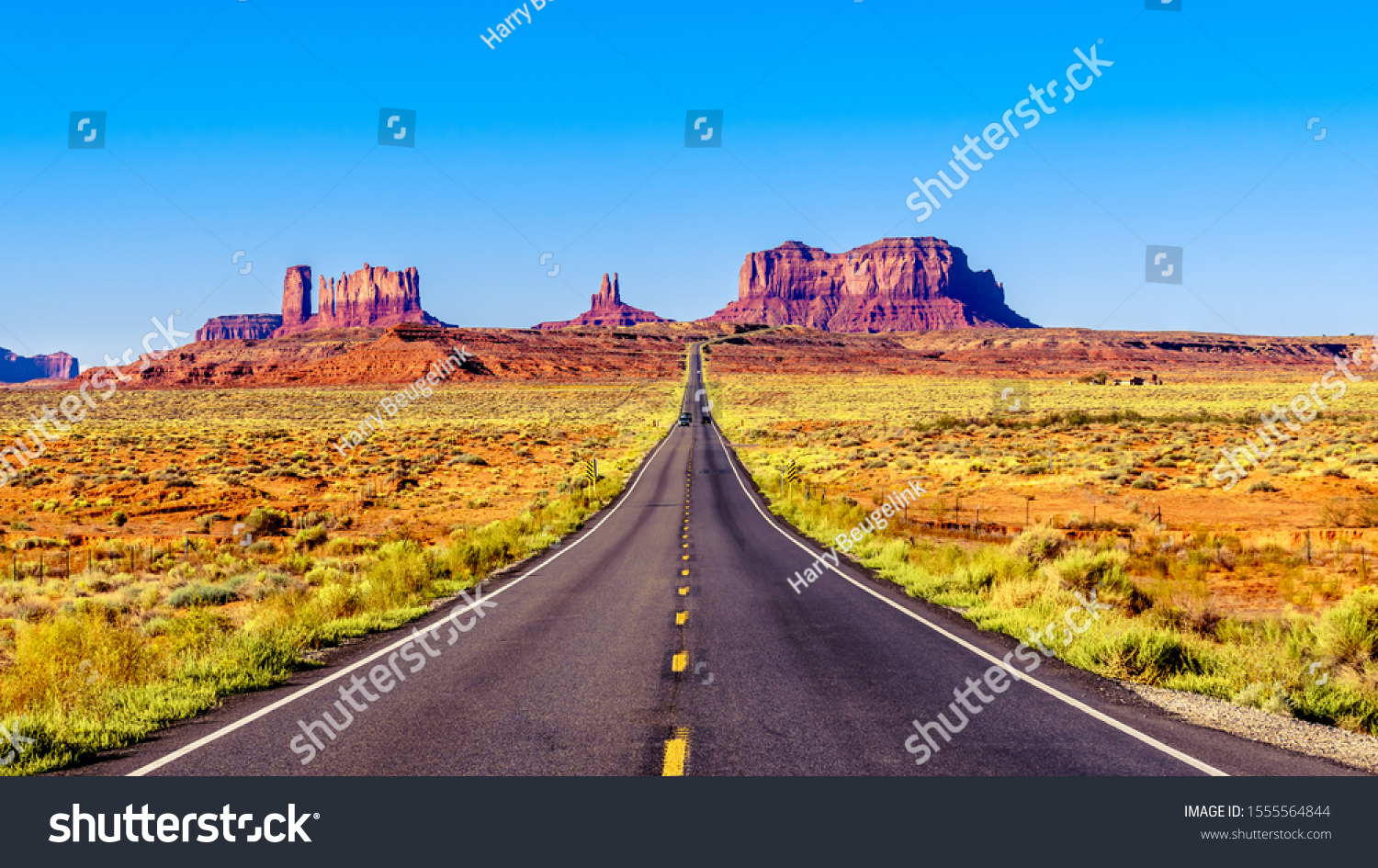 Highway 163 leading to the towering sandstone Buttes and Mesas of the Monument Valley Navajo Tribal Park in Utah-Arizona, United States. 'Forest Gump Point' where he stopped his cross country run #1555564844