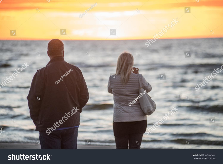 Jurmala, Latvia. Sunset at the Baltc sea. Man and woman at sunset #1555637657