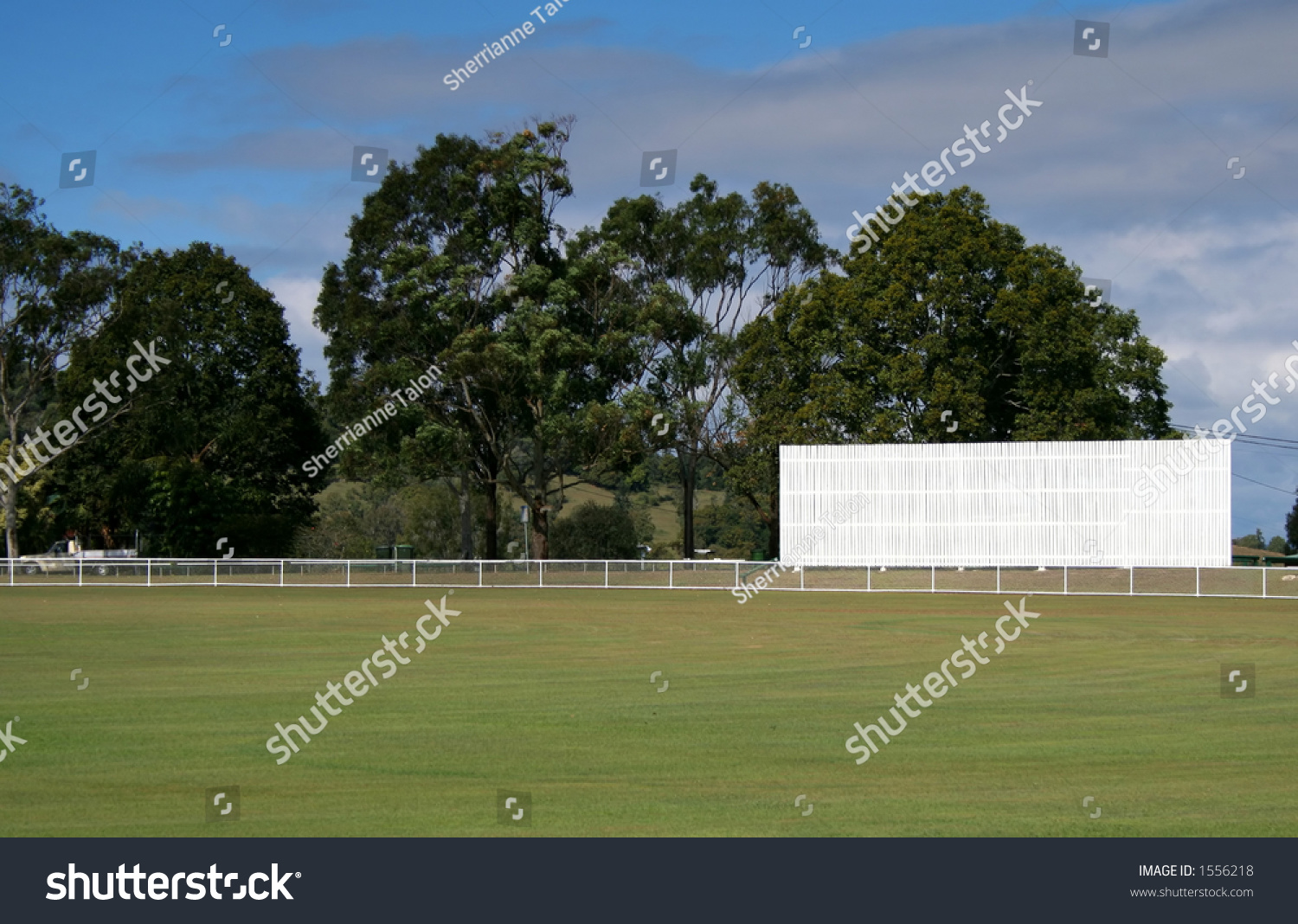 Community Cricket Ground With Blank White Sign Stock Photo 1556218 ...: shutterstock.com/pic-1556218/stock-photo-community-cricket-ground...