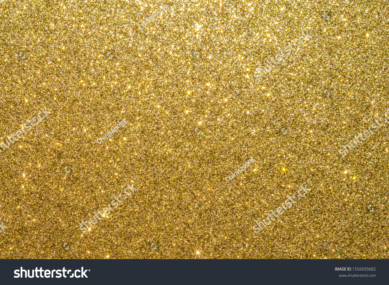 Gold glitter texture background sparkling shiny wrapping paper for Christmas holiday seasonal wallpaper  decoration, greeting and wedding invitation card design element #1556935682