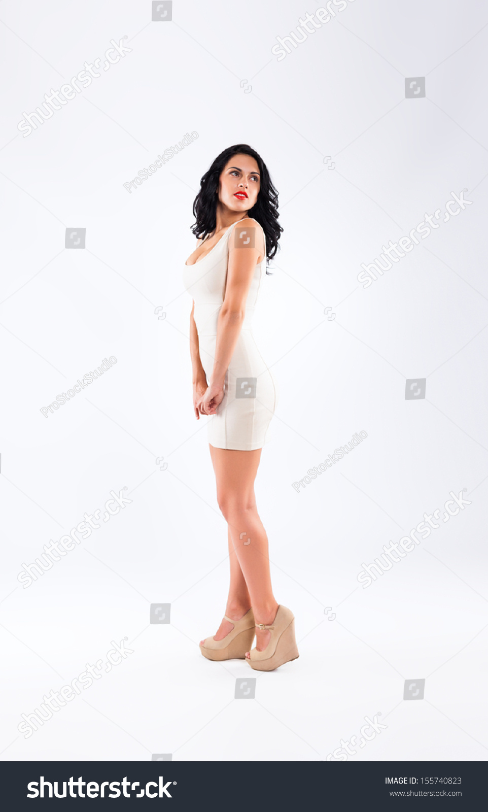 bc89b9e2f4c Fashion woman posing over gray background looking up side up empty copy  space