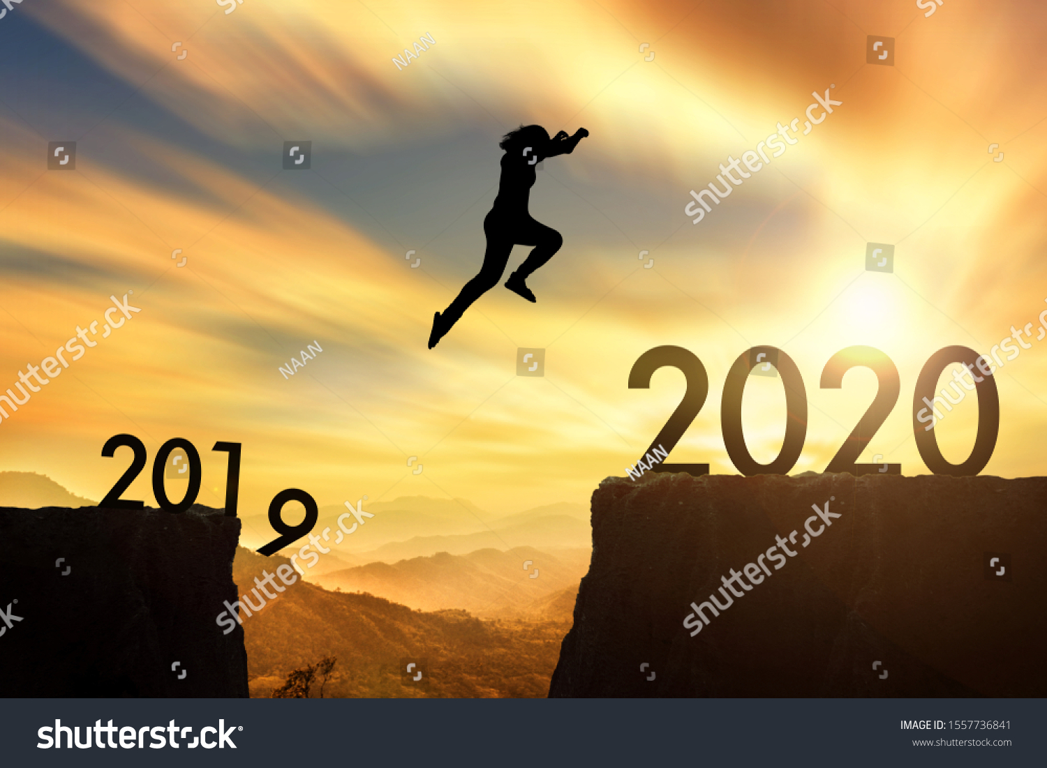 The woman jumping from 2019 cliff to 2020 cliff on sunrise time #1557736841