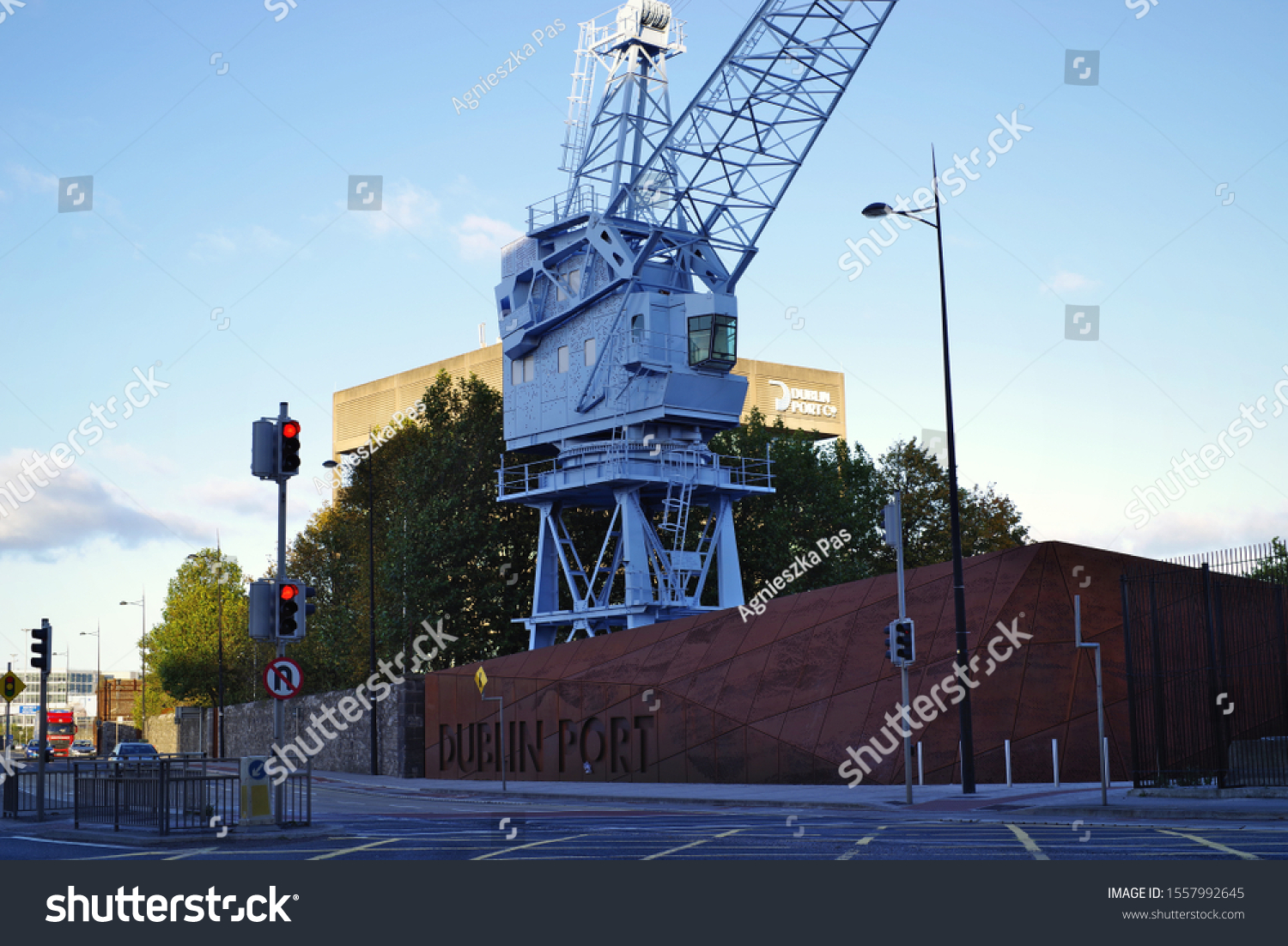 DUBLIN, IRELAND - November 08, 2019: Dublin Port Company in Eastpoint Business Park. Street view of the company name with old renovated crane as logo. Dublin Port building in the background.