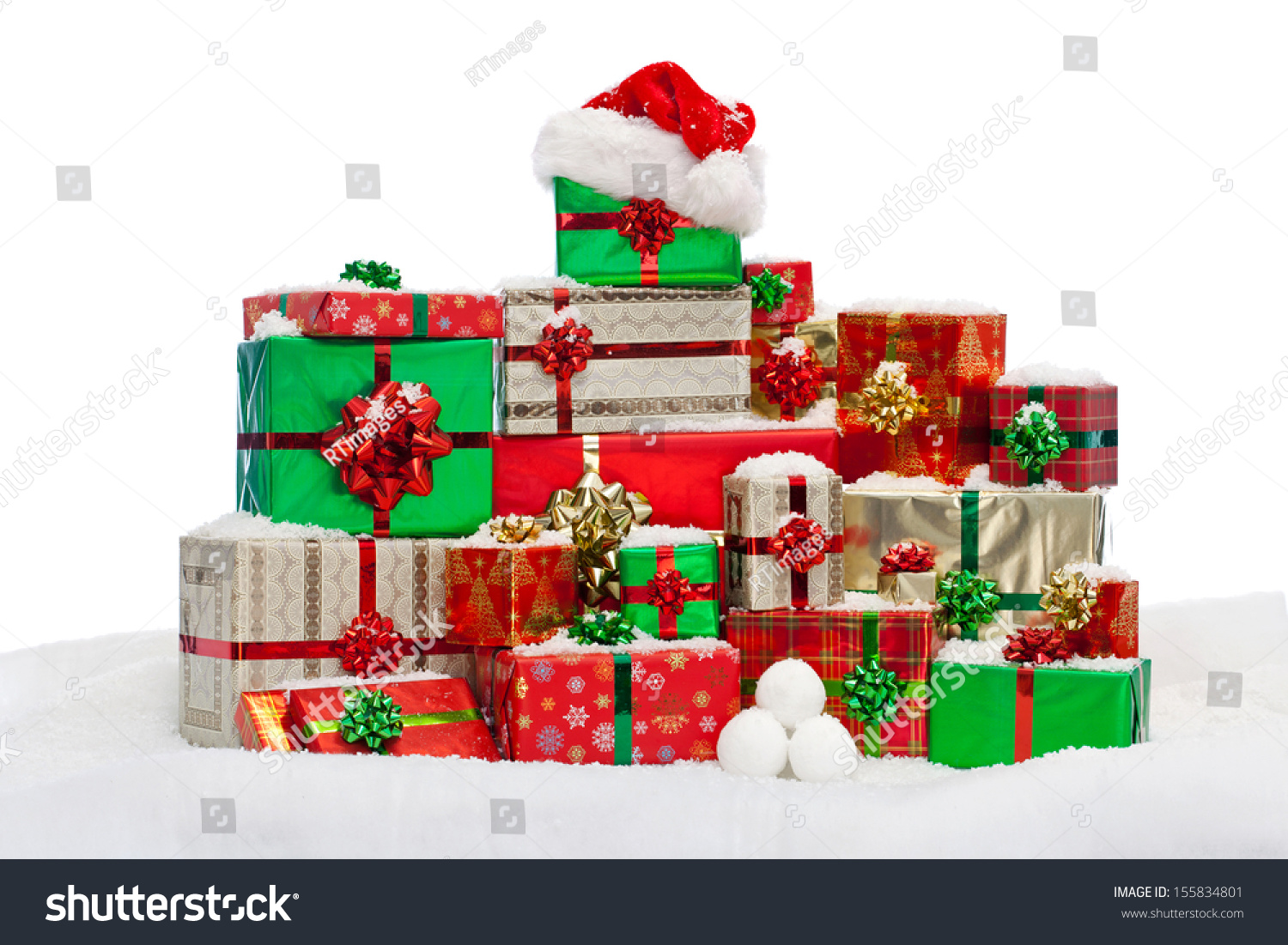 A stack of gift wrapped christmas presents on snow