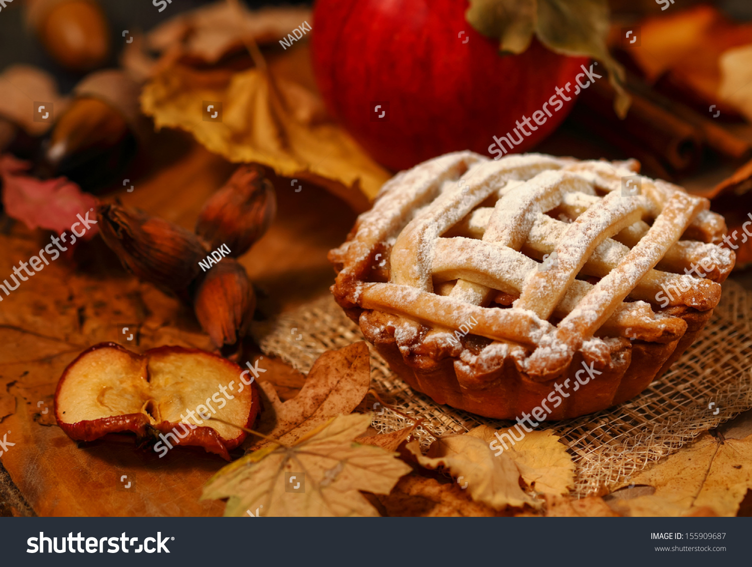 Arrangement of home-made apple pie in autumnal decor #155909687