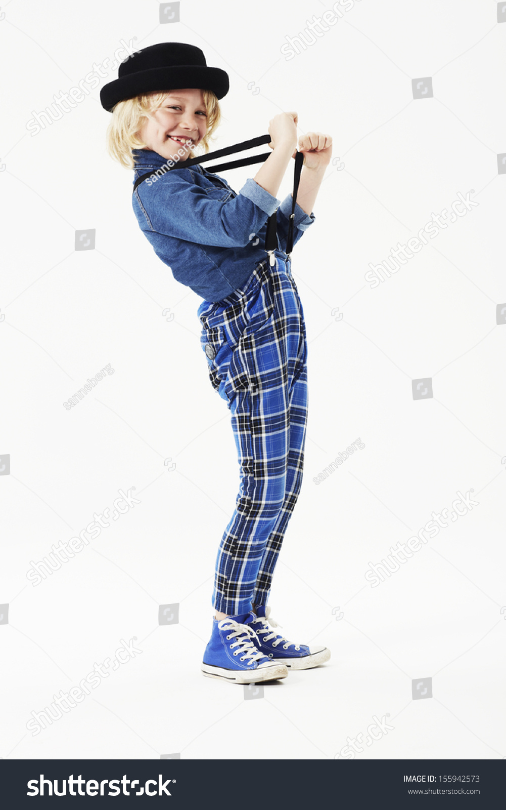 Boy Pulling Braces Studio Stock Photo 155942573 - Shutterstock