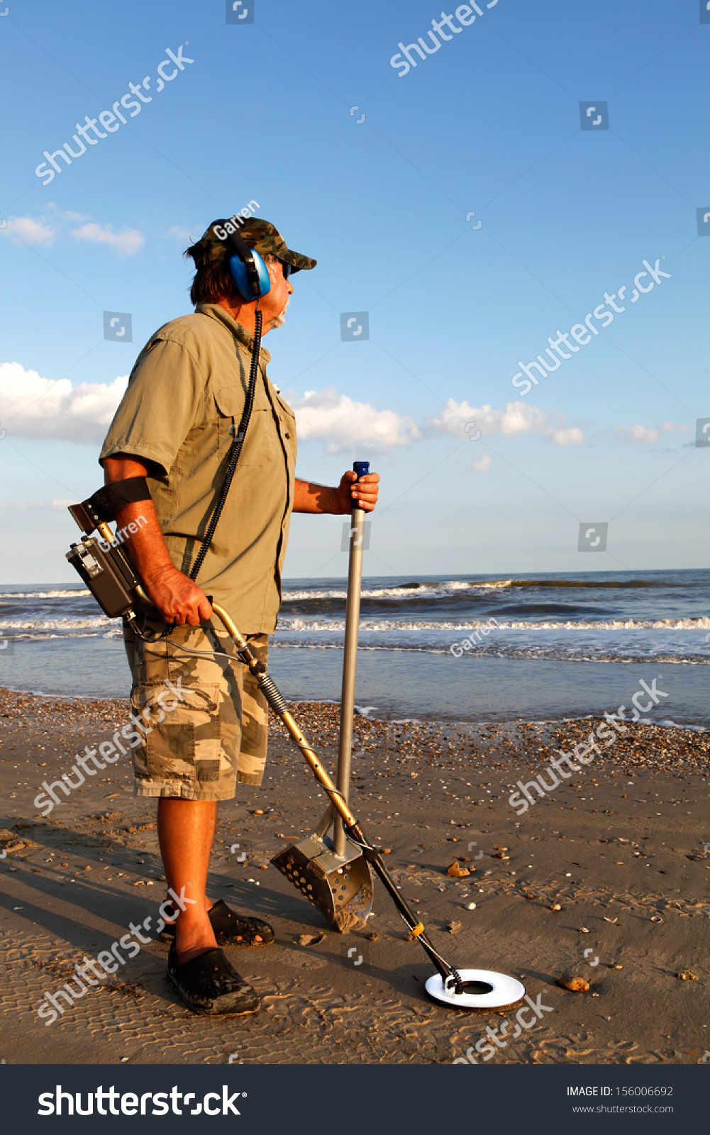 Jew Detector: Man Metal Detecting On Beach Stock Photo 156006692