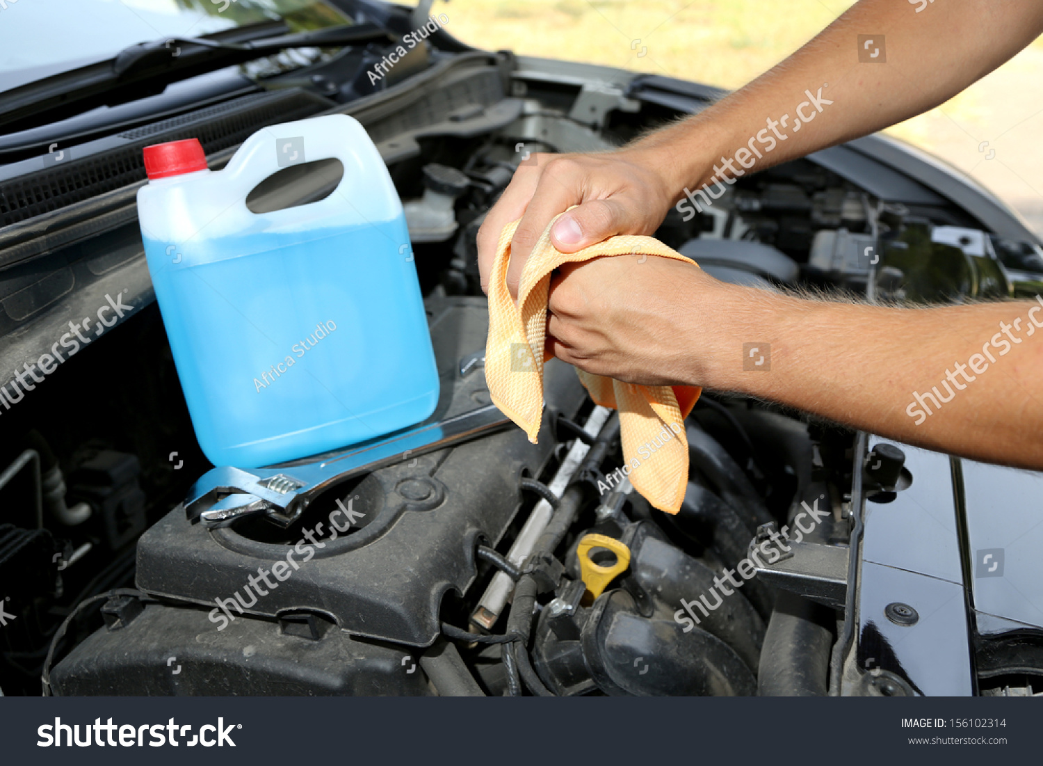 Motor Mechanic Cleaning His Greasy Hands After Servicing