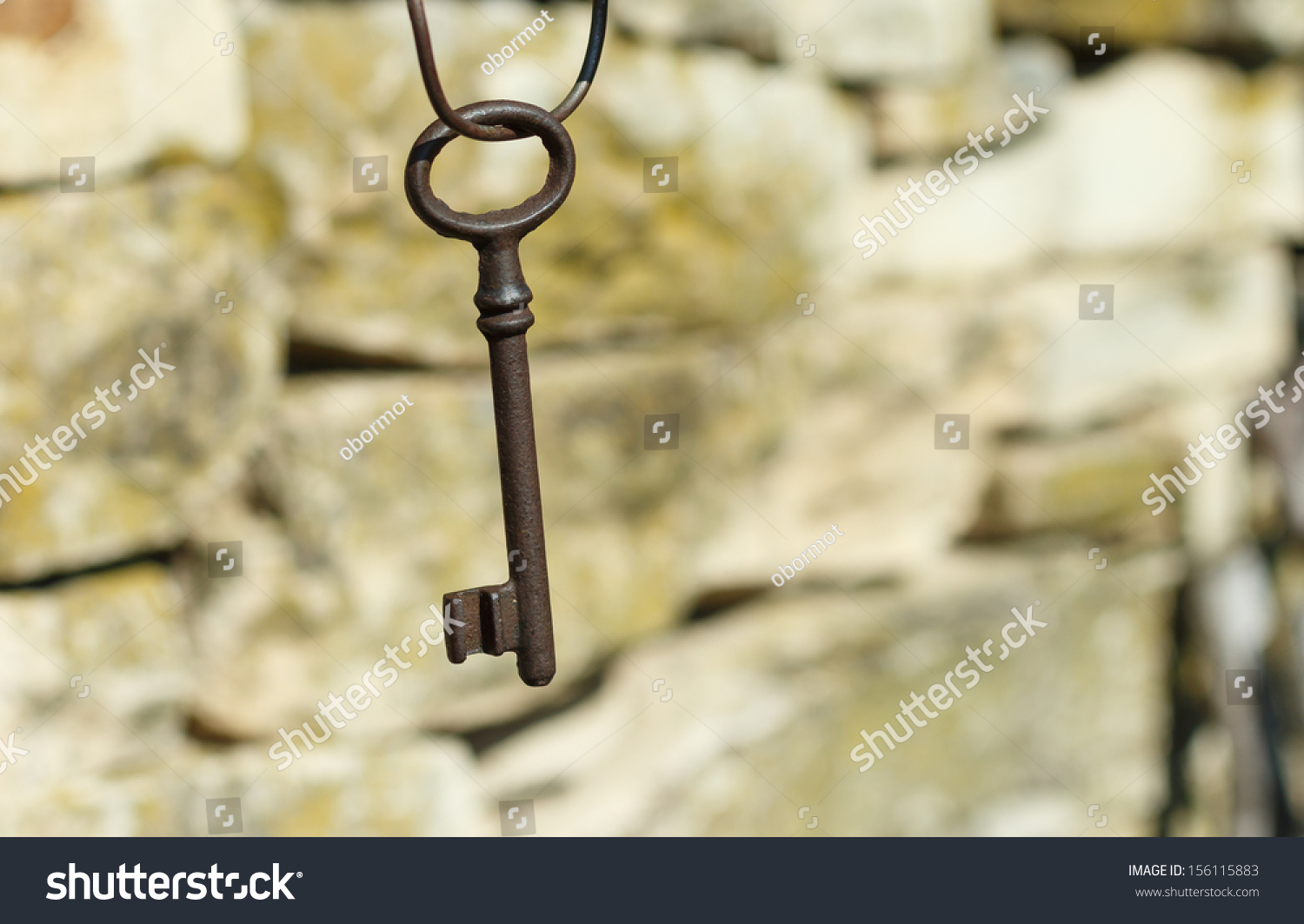 Old Key Hanging On Stone Wall Stock Photo (Edit Now) 156115883 ...