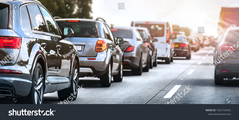 Car rush hours city street. Cars on highway in traffic jam #1561724425