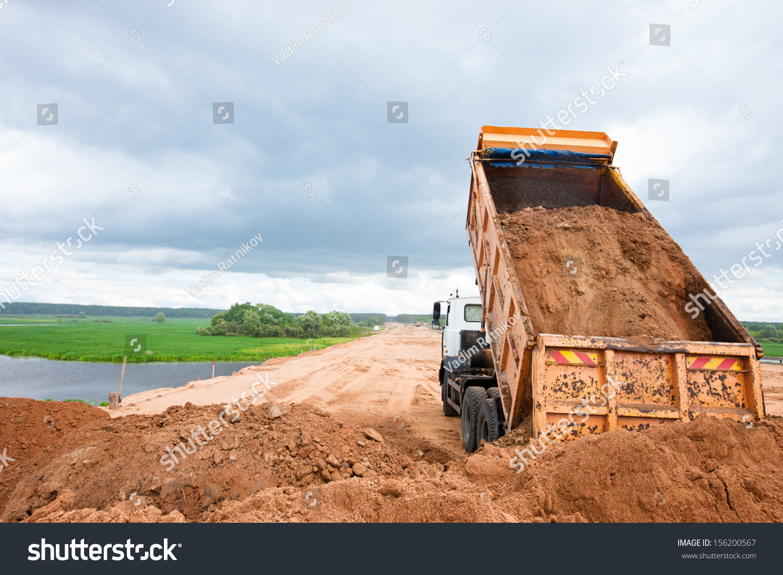 Construction Site Soil : Dump truck unloading soil sand construction stock photo