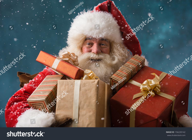 Photo happy santa claus outdoors snowfall stock