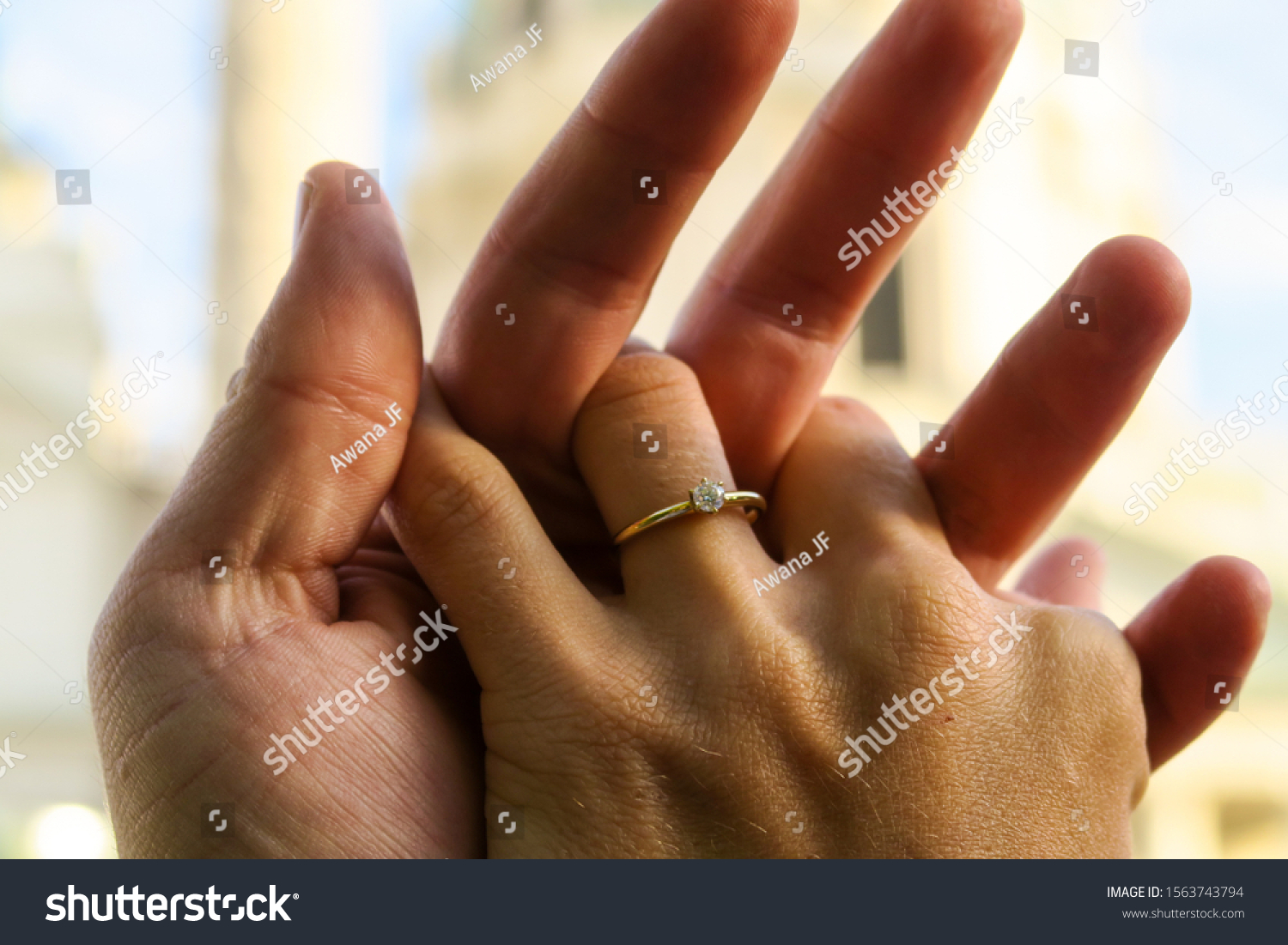 stock-photo-closeup-of-lovers-hands-with