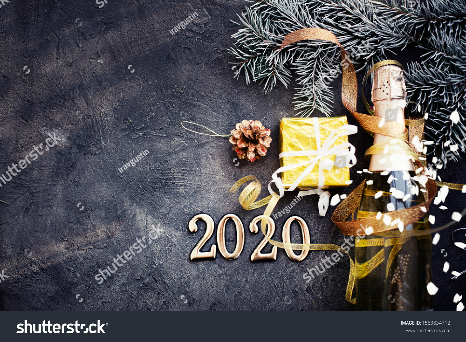 happy new year 2020 background with champagne in dark color with bokeh #1563834712