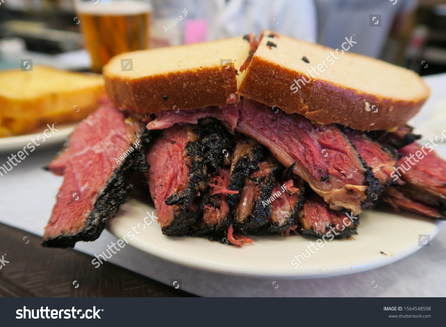 stock-photo-smoked-ham-sandwich-on-a-pla