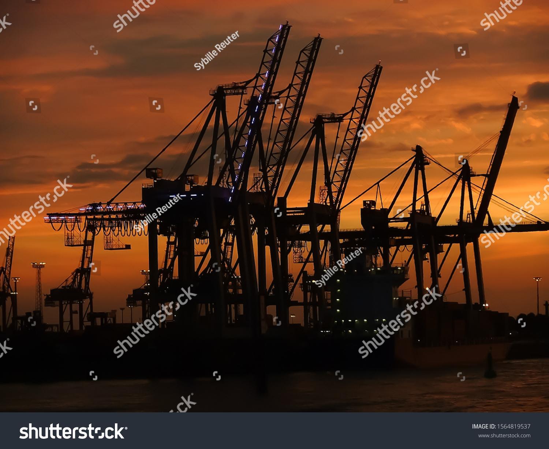 stock-photo-cargo-cranes-silhouettes-aga