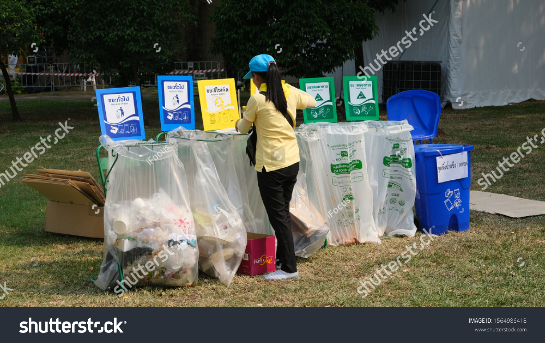 BANGKOK, THAILAND - NOVEMBER 17, 2019: An employee stands near transparent trash bags for selective garbage disposal during the Red Cross Fair 2019 on November 17, 2019 in Bangkok, Thailand