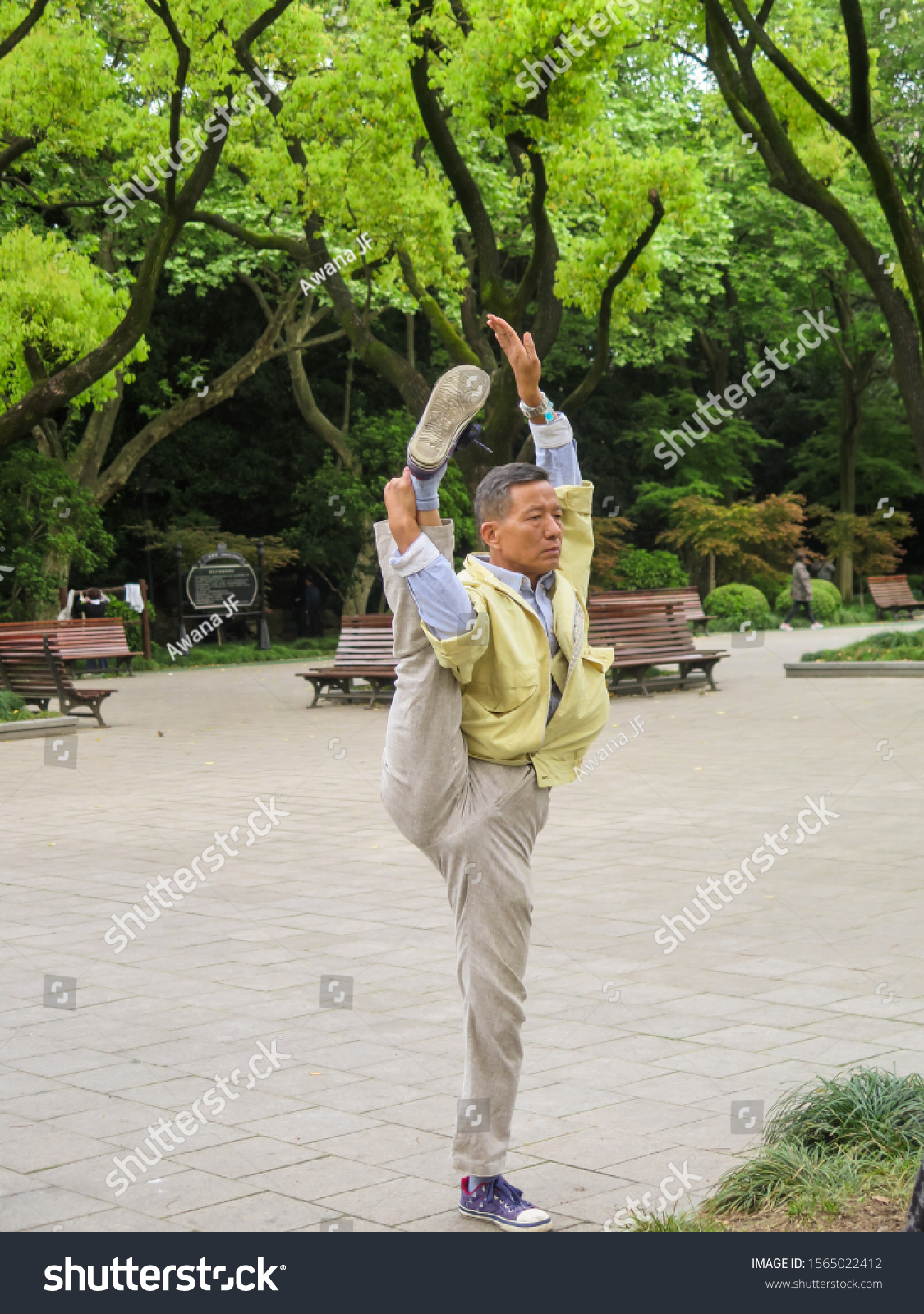 Shanghai, China - April 2017: Chinese man practicing stretching in a park