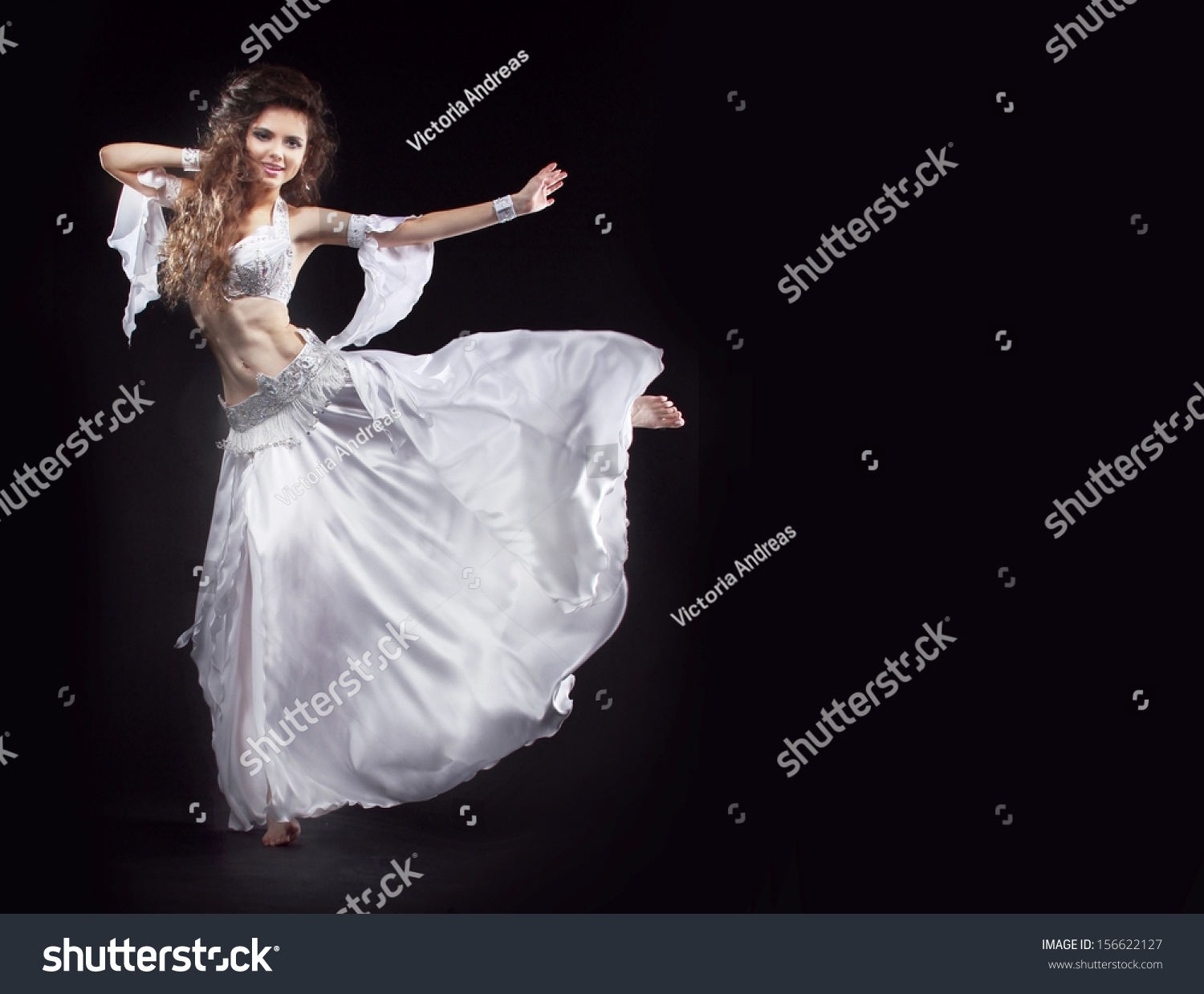 295f0a89da0 Beauty Girl belly dancer in white suit oriental dance in motion isolated on  black background