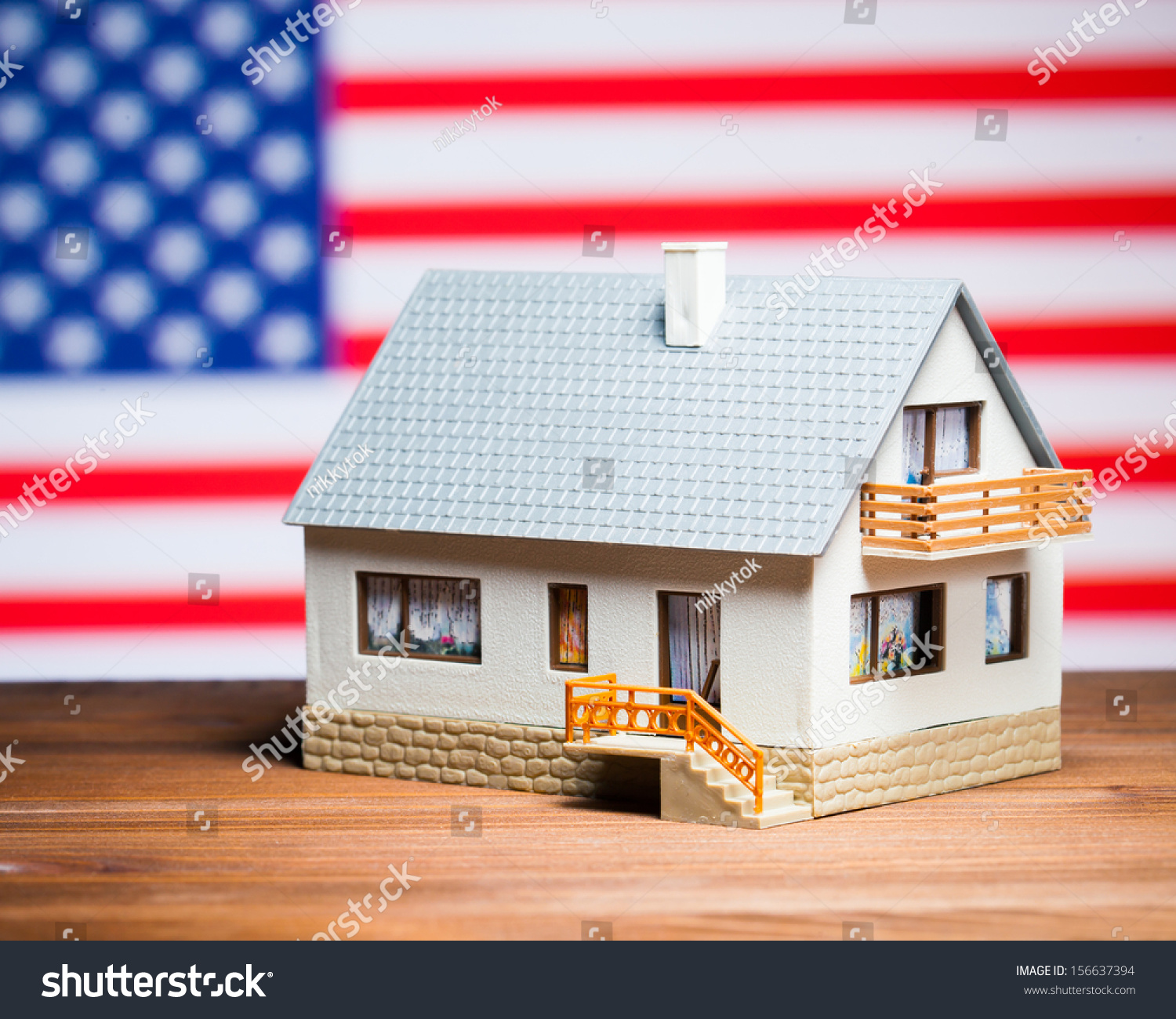 Usa Real Estate Concept House Against American Flag Stock