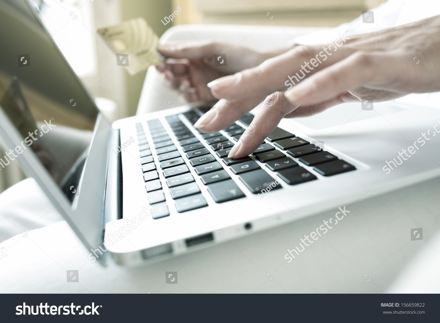 close up woman 39 s hands holding a credit card and using computer keyboard for online shopping. Black Bedroom Furniture Sets. Home Design Ideas