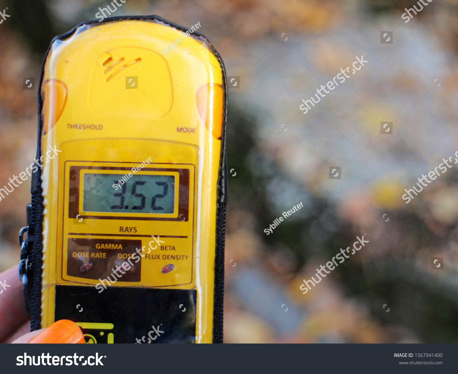 stock-photo-a-dosimeter-is-held-showing-