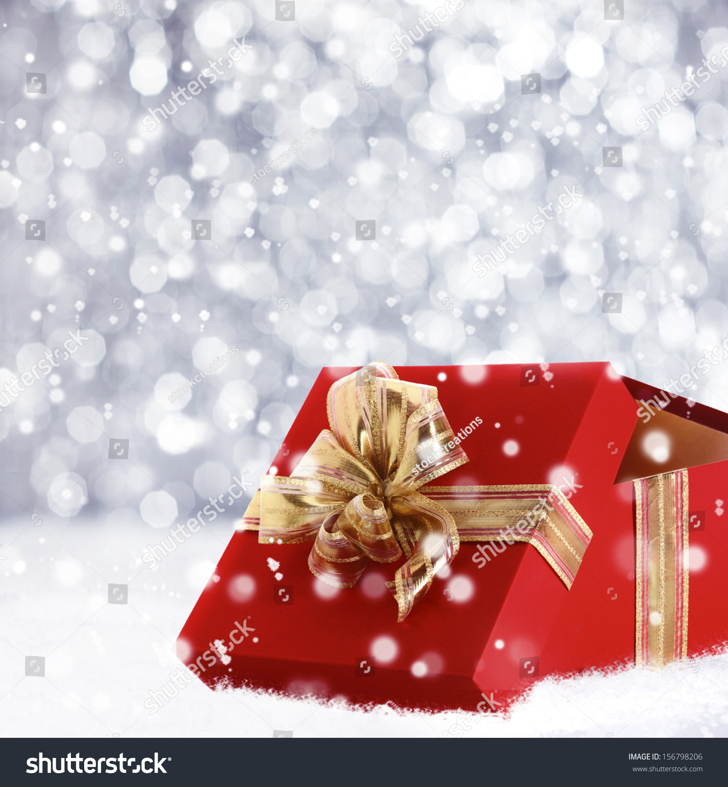 Red christmas gift box lid propped stock photo
