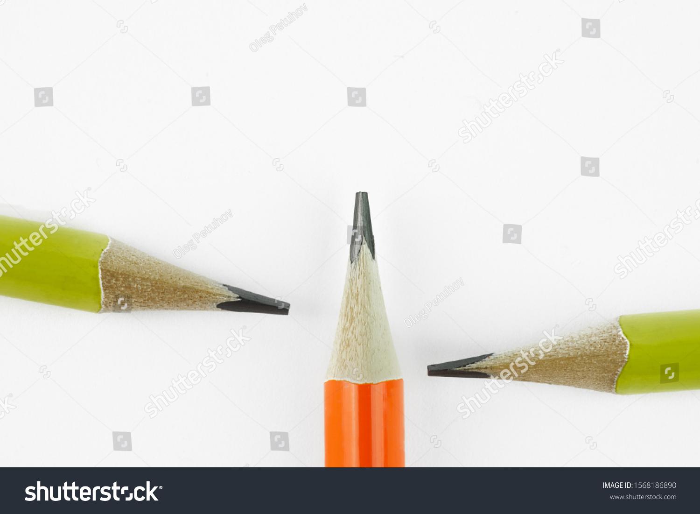 closeup three yellow pencils on white background. #1568186890