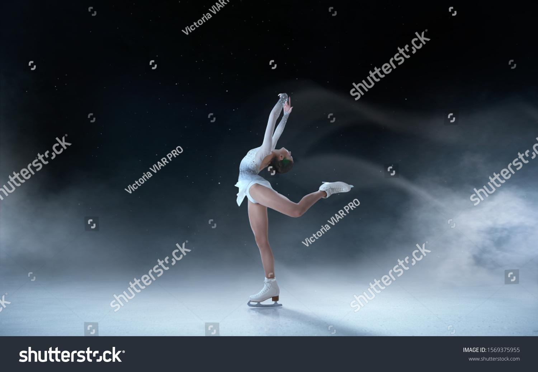 Figure skating girl skating on ice. #1569375955