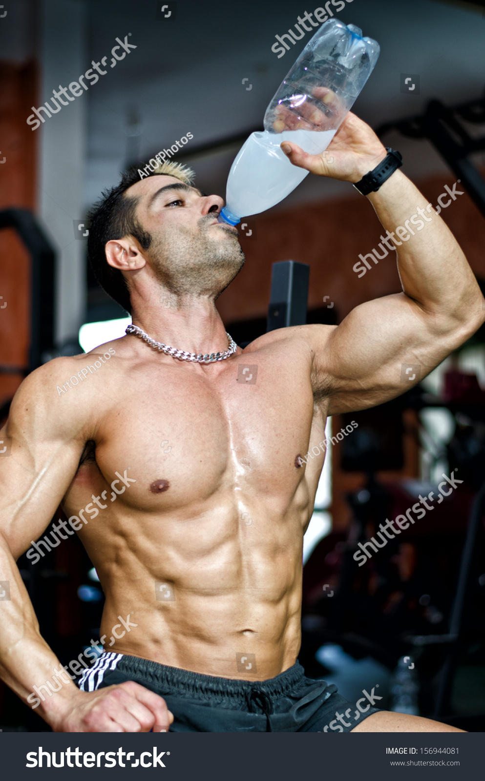 Muscular male bodybuilder gym drinking water stock photo 156944081 muscular male bodybuilder in a gym drinking water or energy drink from bottle sciox Gallery